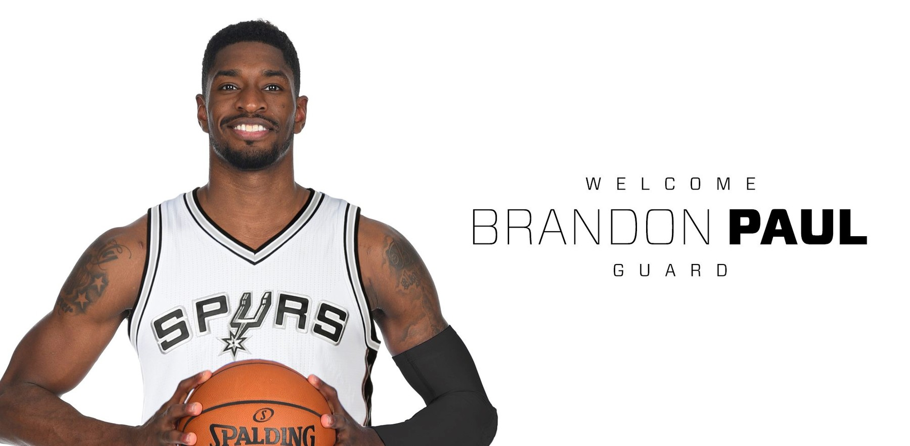 Brandon Paul wearing Spurs jersey