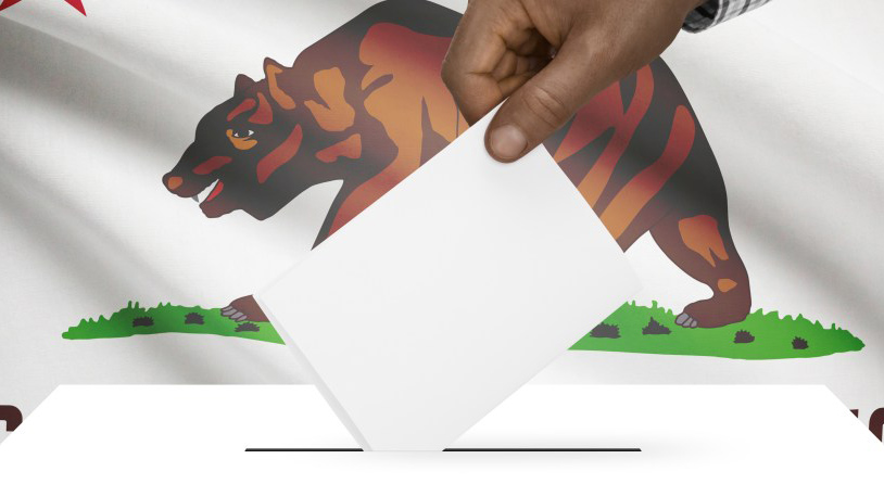 Graphic via Shutterstock. Hand inserts ballot into box in front of California state flag