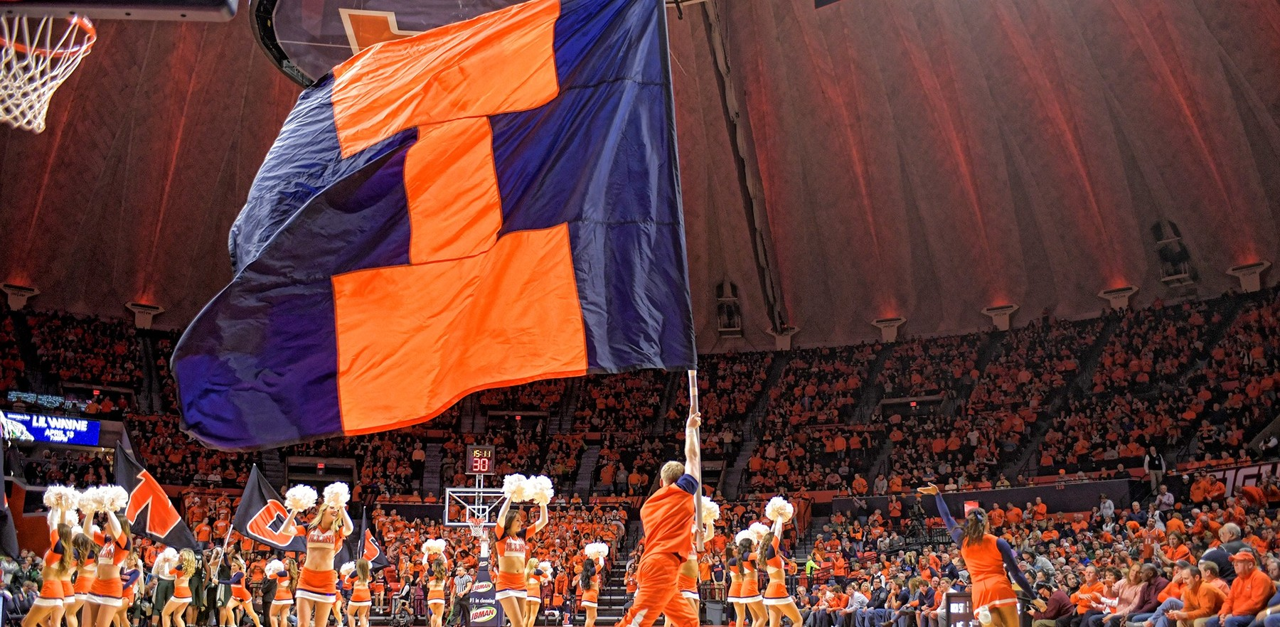 large 'Block I' flag is waved on the floor of the State Farm Center