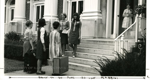 New residents being greeted at the entrance to Busey Hall in the 1960s. Photo courtesy of the University Archives