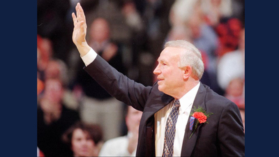 Illinois coach Lou Henson acknowledges a packed Assembly Hall during a ceremony following Henson's final regular-season home game on March 9, 1996. Henson coached the Illini for 21 seasons. (JOHN DIXON / AP)