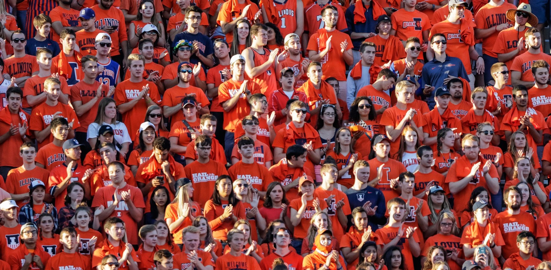 orange-clad students in the Block I cheering section