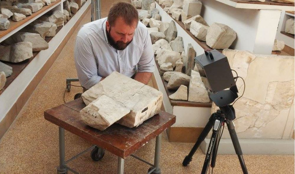 Daniel Leon uses a 3D scanner in Athens to learn more about a second century historian who studied Alexander the Great. Photo courtesy of K.A. Rask