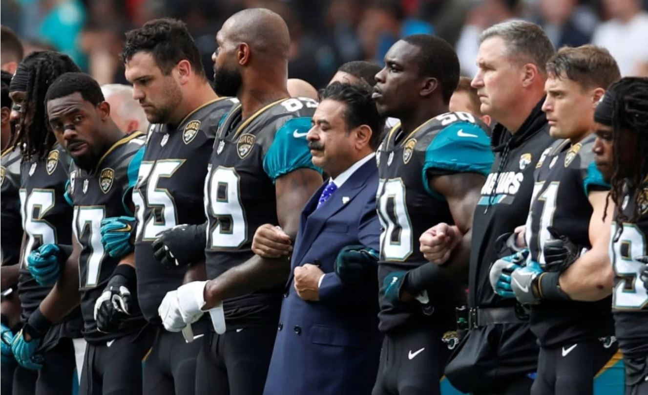Shahid Khan stands with players during the National Anthem. Photo by Paul Childs/Action Images via Reuters