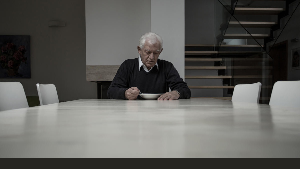Adobe Stock image of an elderly man eating alone