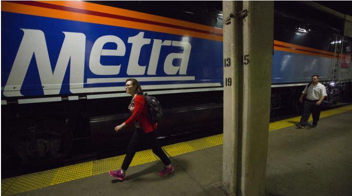 passenger walks aside a Metra train