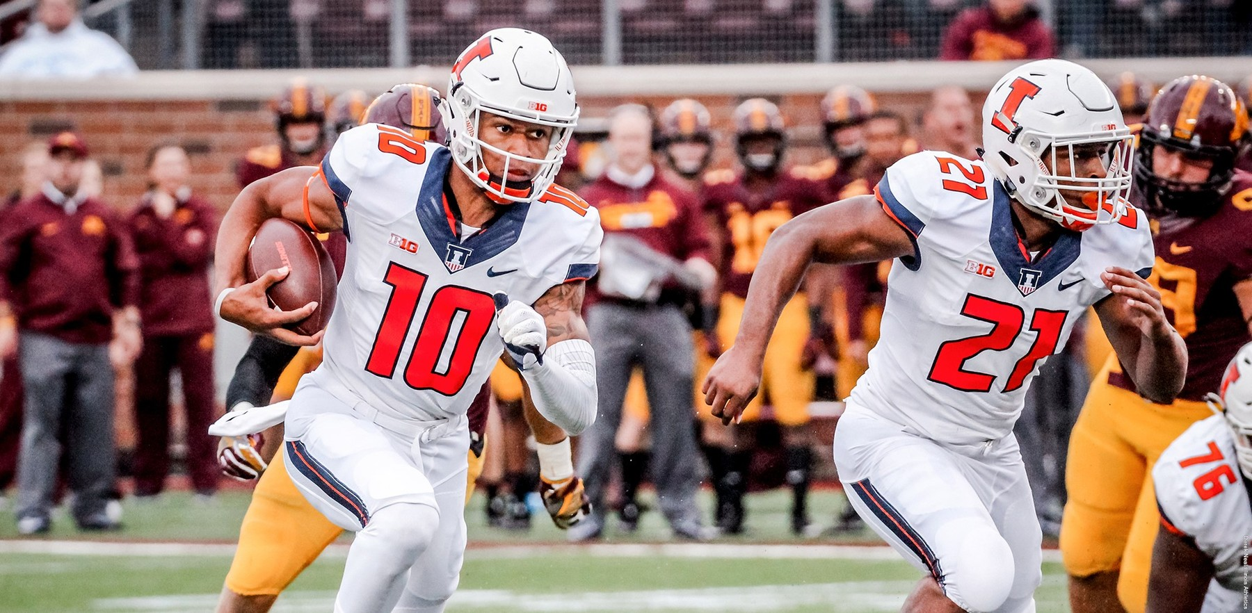 Freshman quarterback Cam Thomas runs the ball during his first appearance with the Illini