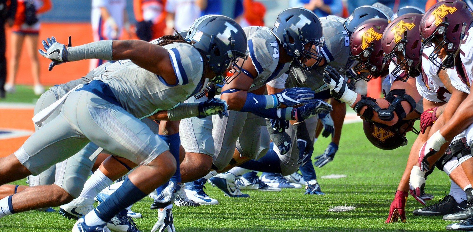 Illini football linemen wearing 'gray ghost' uniforms