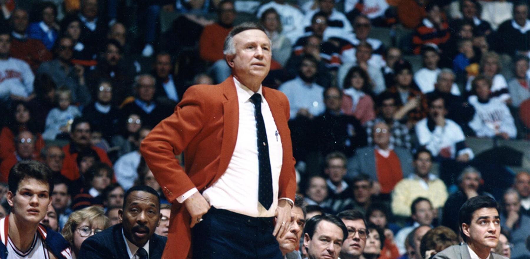 Lou Henson coaching in his signature orange blazer