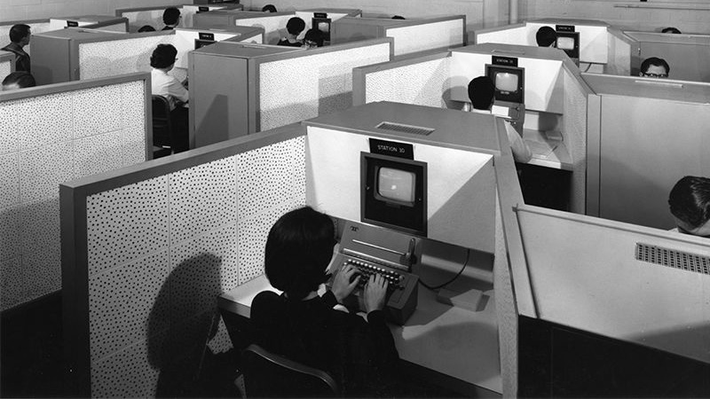 campus archive photo of students at early PLATO computer terminals