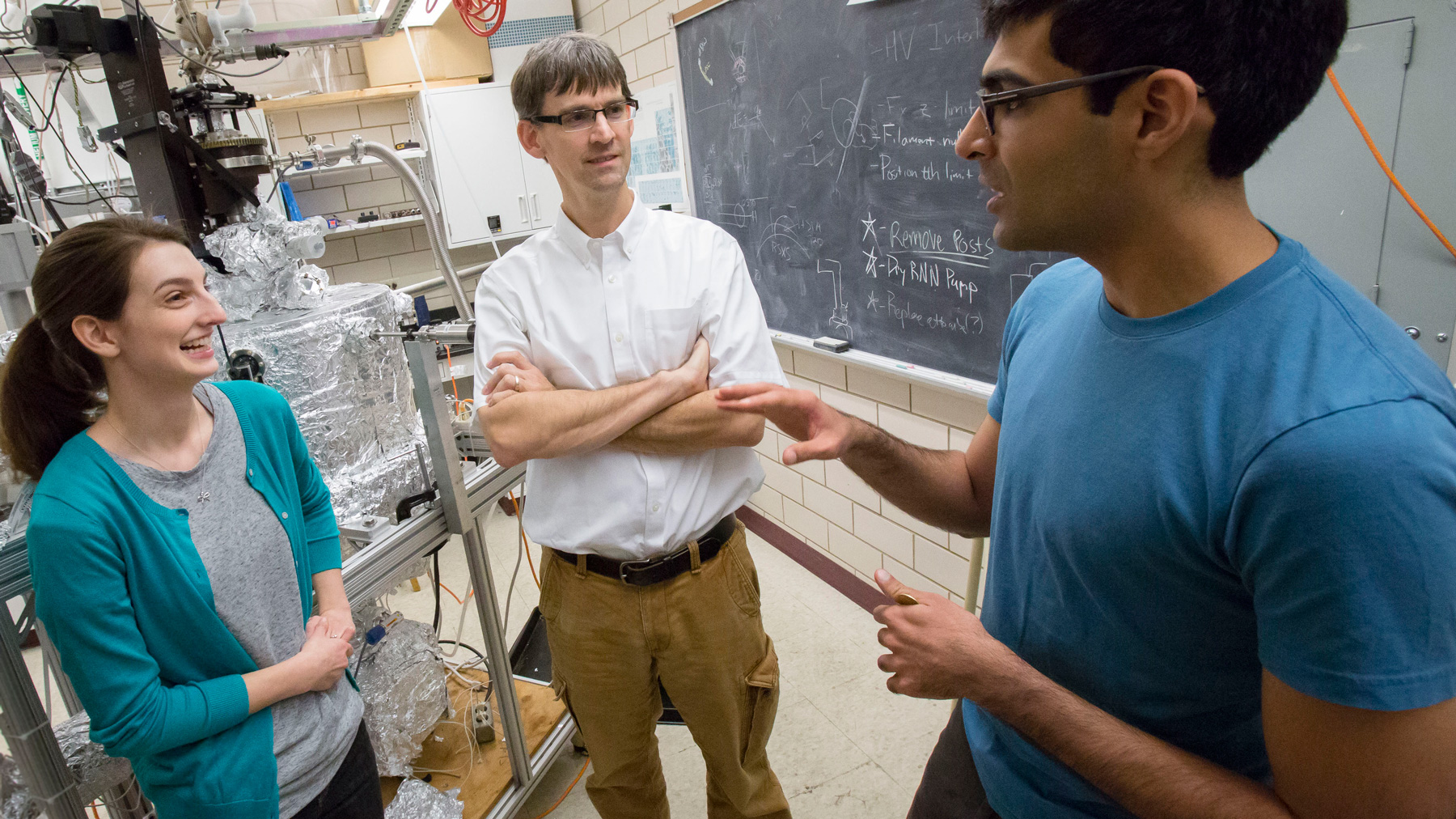 Professor of Physics Peter Abbamonte (center) works with graduate students Anshul Kogar (right) and Mindy Rak (left) in his laboratory at the Frederick Seitz Materials Research Laboratory. Photo by L. Brian Stauffer,