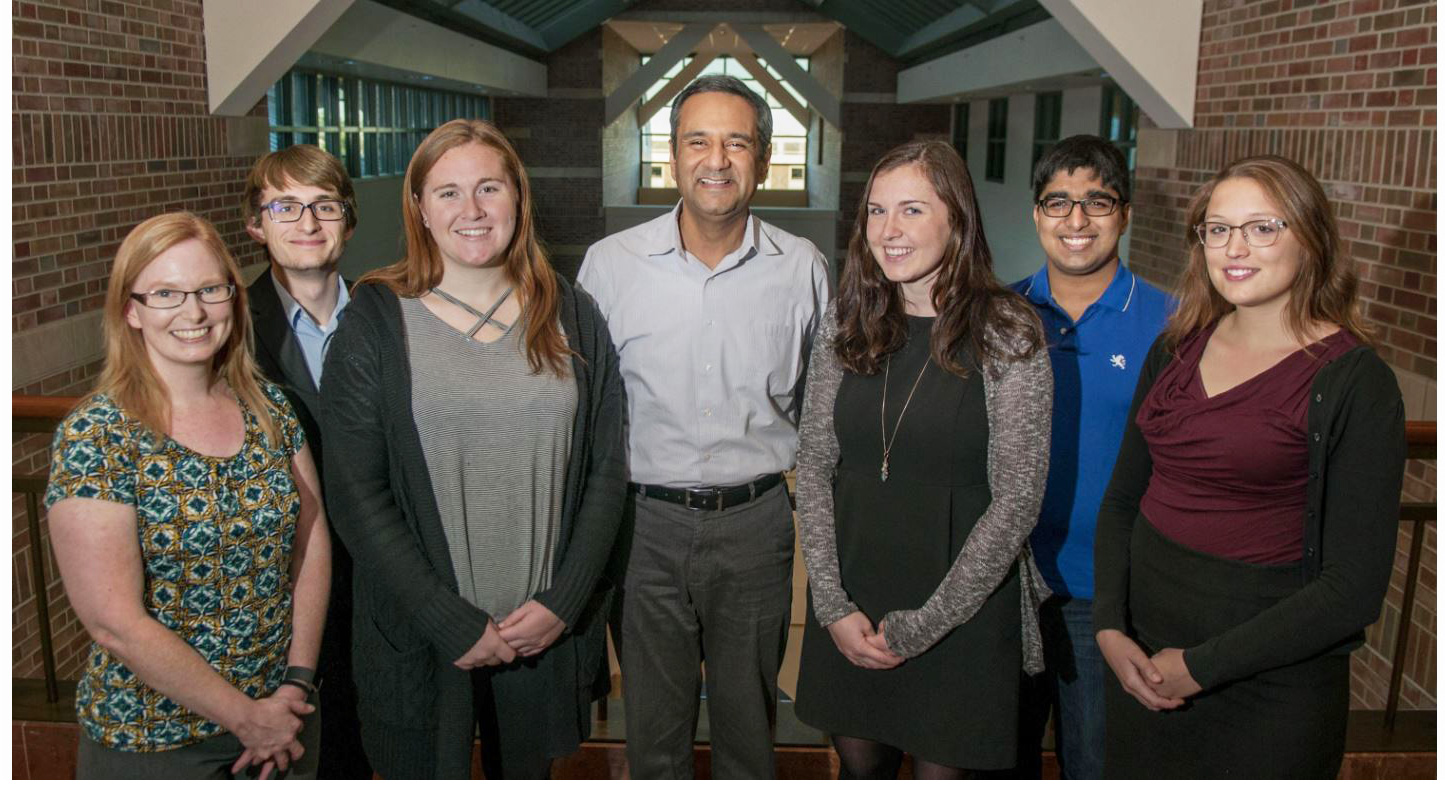Cancer Scholars director Rohit Bhargava (center) joins program advisor Marcia Pool (far left) and a few of the first cohort of undergraduate students