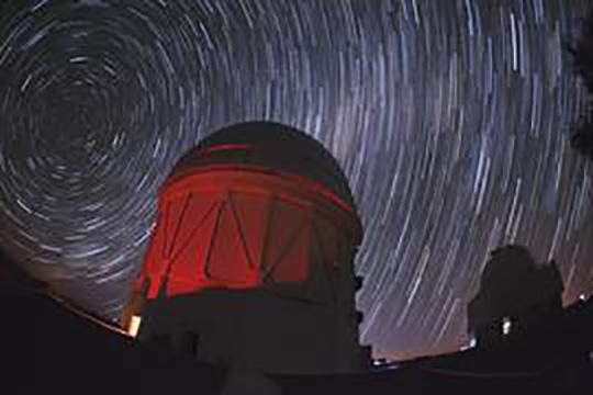 Blanca telescope and star trails. Photo by Reidar Hahn for Fermilab