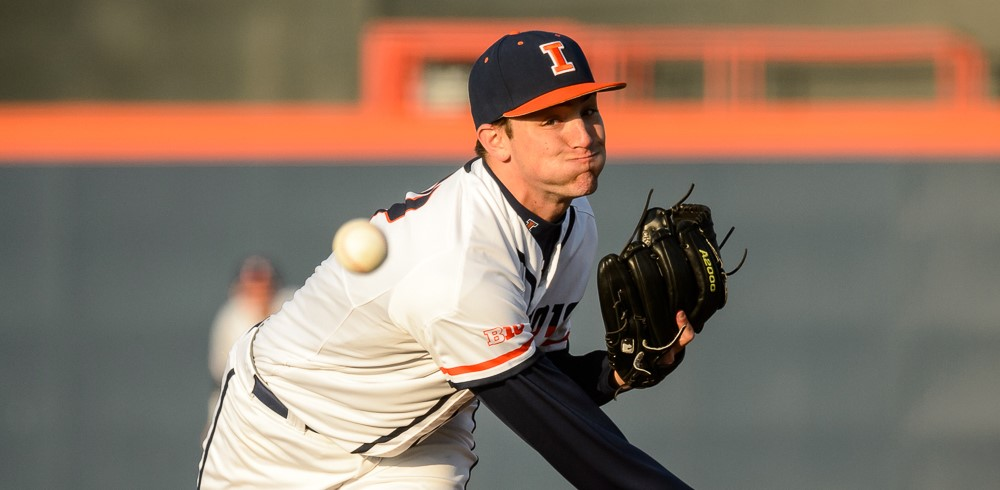 hurled pitch in forground as Illini pitcher follows through