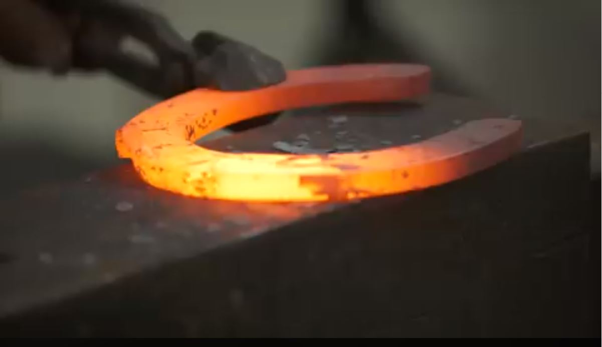 red-hot horseshoe being forged at Illinois