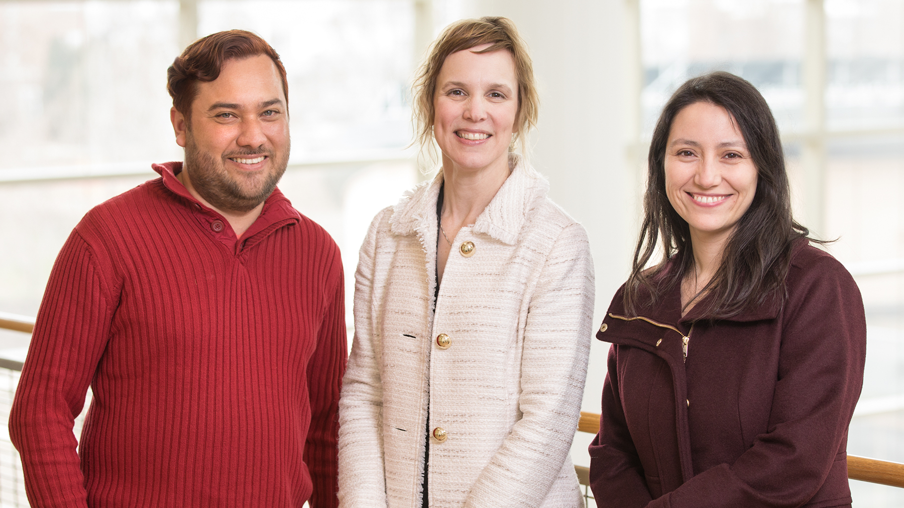Speech and hearing science professor Laura DeThorne and doctoral students Henry Angulo and Veronica Vidal