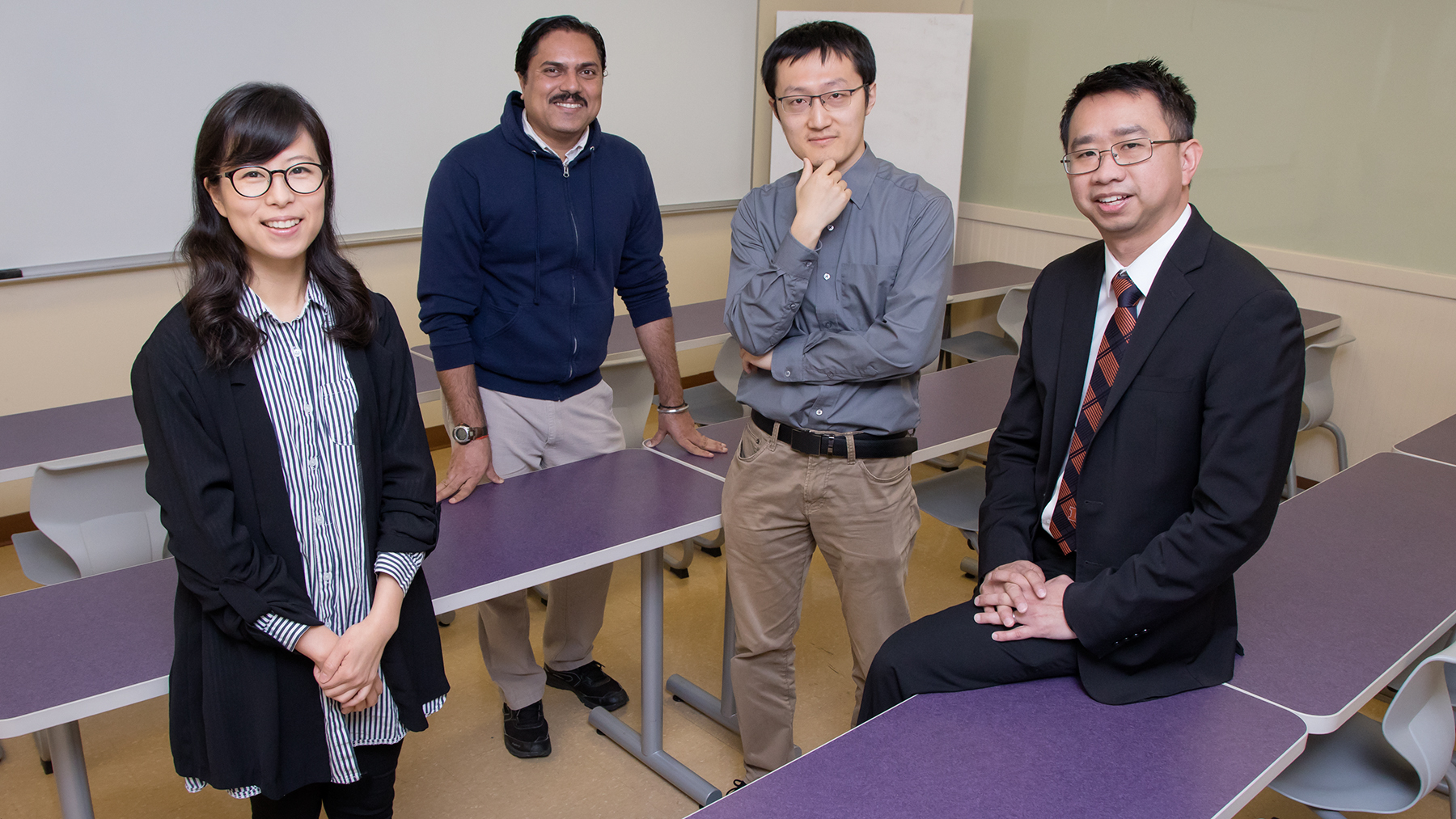 The team led by social work professor Kevin Tan, right, includes graduate students Esther Shin, Gaurav Sinha and Yang Wang. Photo by Brian Stauffer