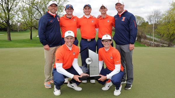 Men's golf team posing with Big Ten championship trophy