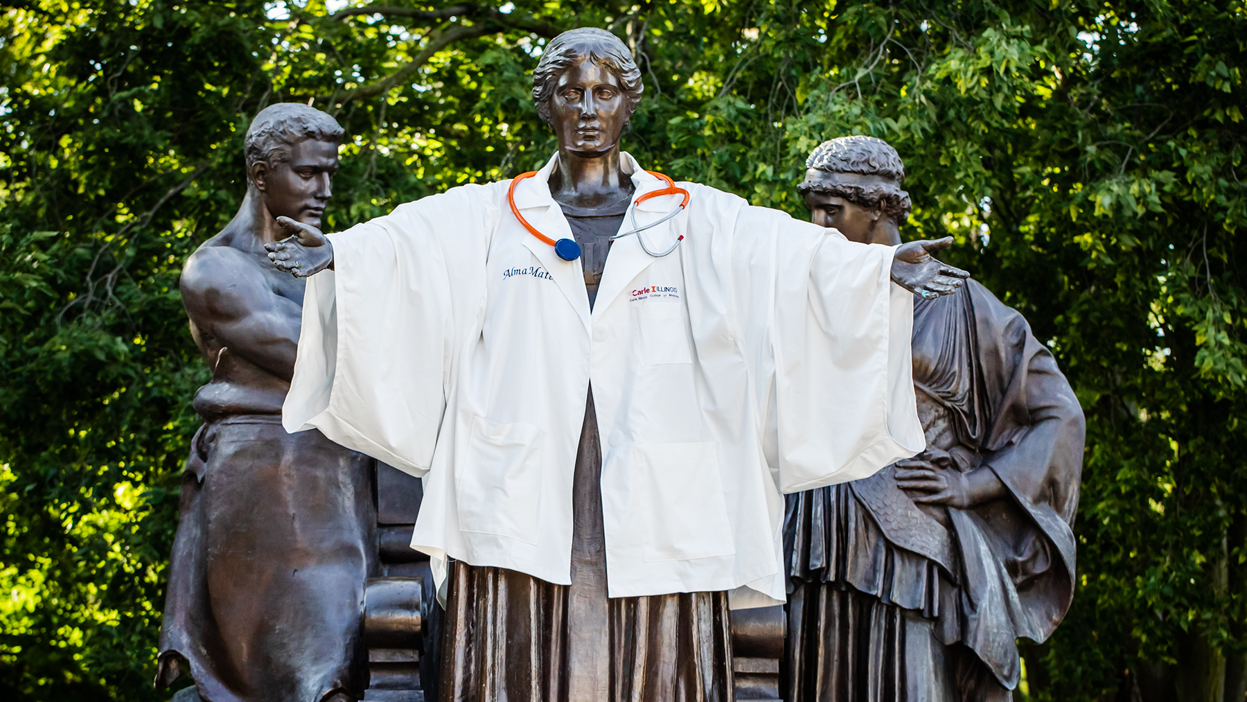 Alma Mater wears a lab coat to welcome the first class of Carle Illinois College of Medicine students