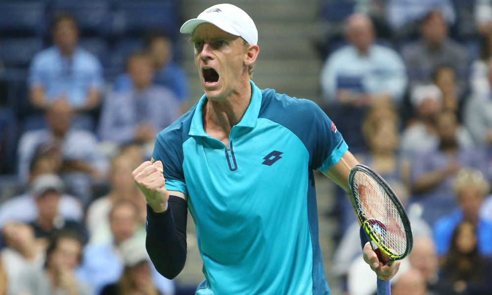Kevin Anderson celebrates a point. Photo by Elsa for Getty Images