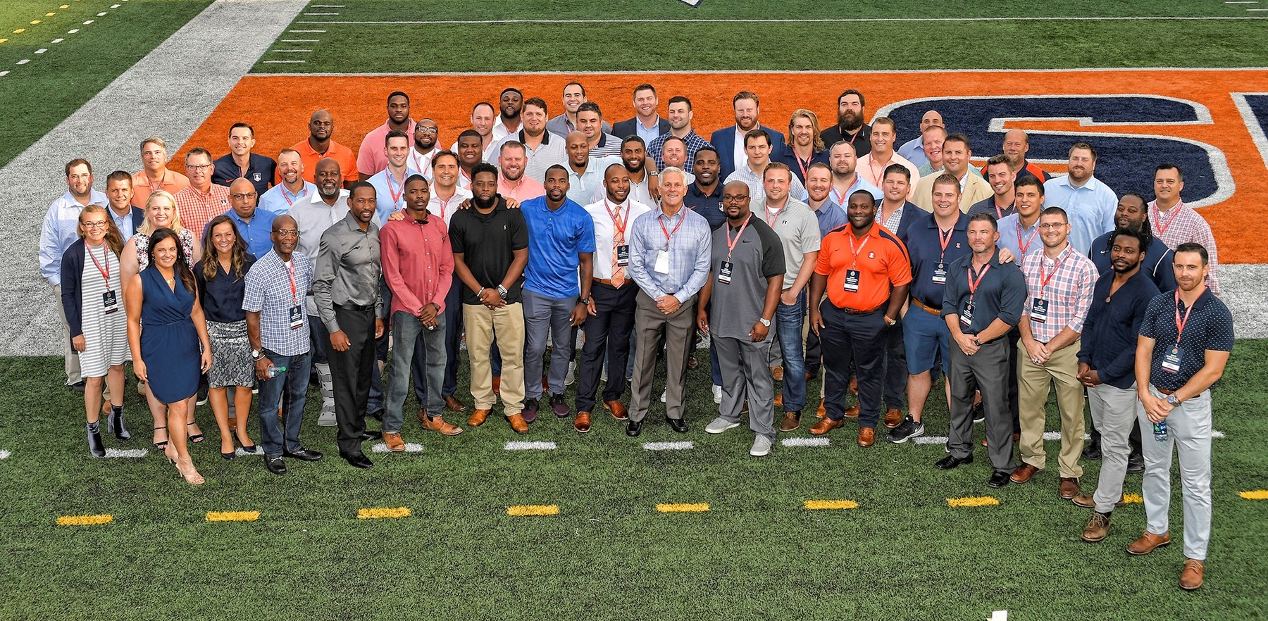 group photo of athletes and coaches who returned to C-U for the reunion