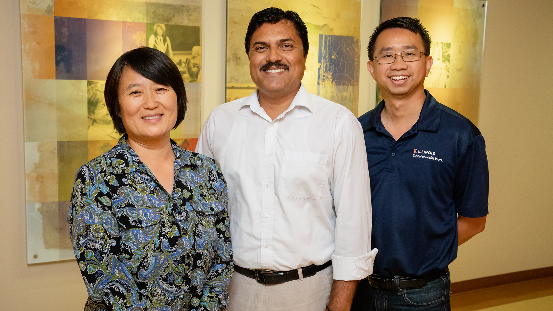 Illinois graduate student Gaurav Sinha conducted the study. Social work professors Min Zhan and Kevin Tan co-wrote the paper. Group photo by L. Brian Stauffer
