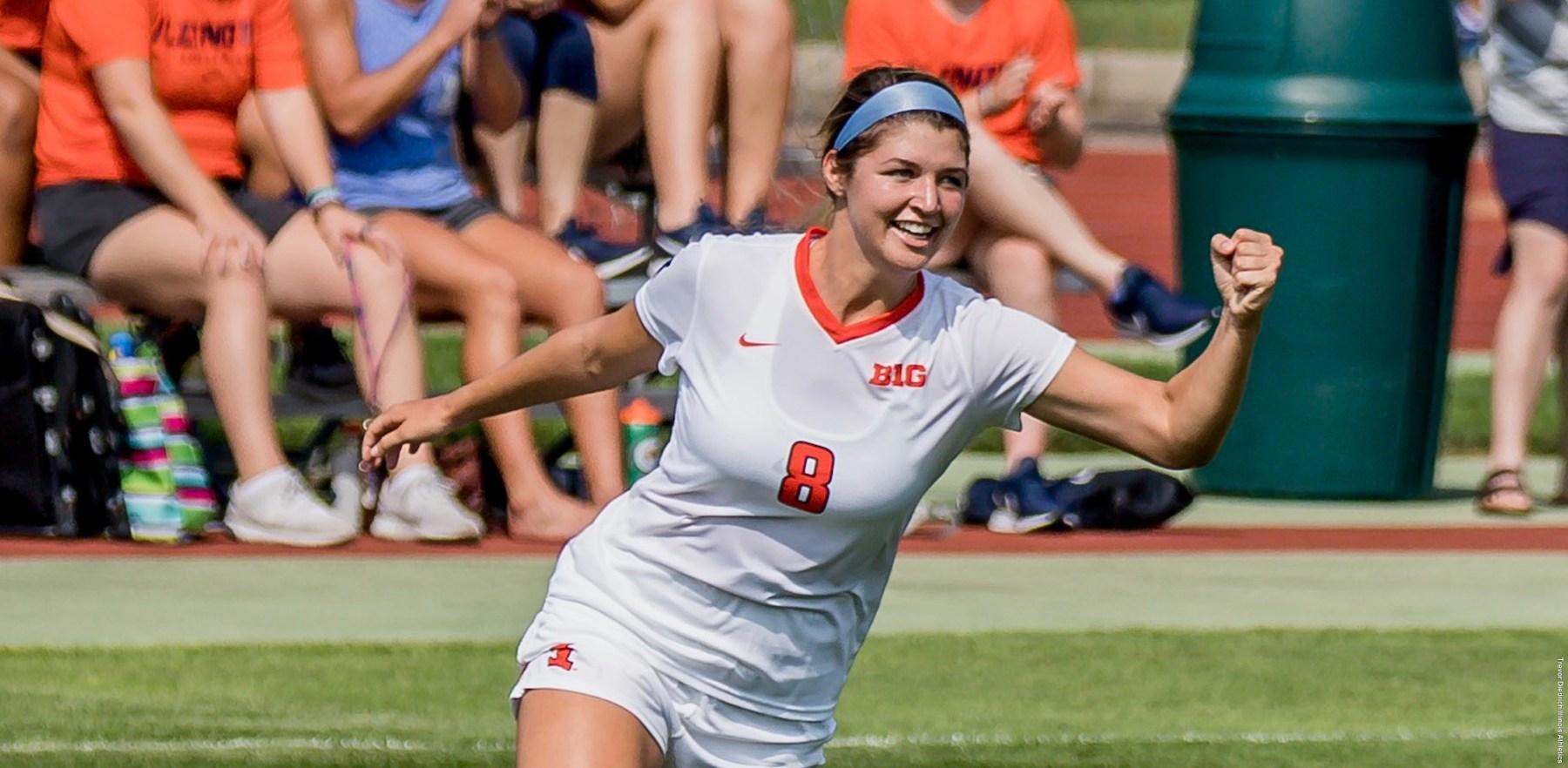 Illini freshman Caroline Ratz celebrates with a raised first