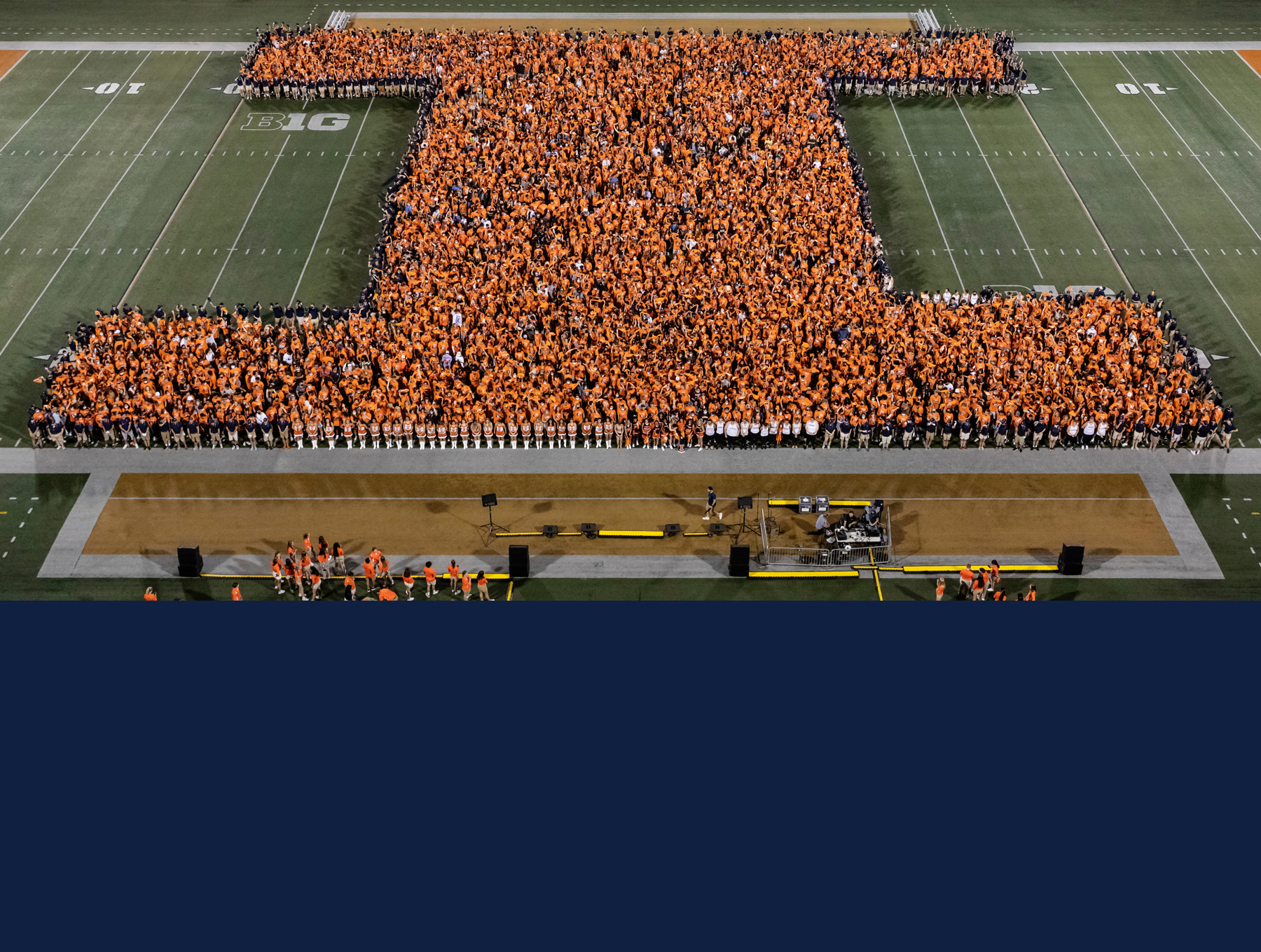 """thousands of new students form a """"Block I"""" on the field of Memorial Stadium"""