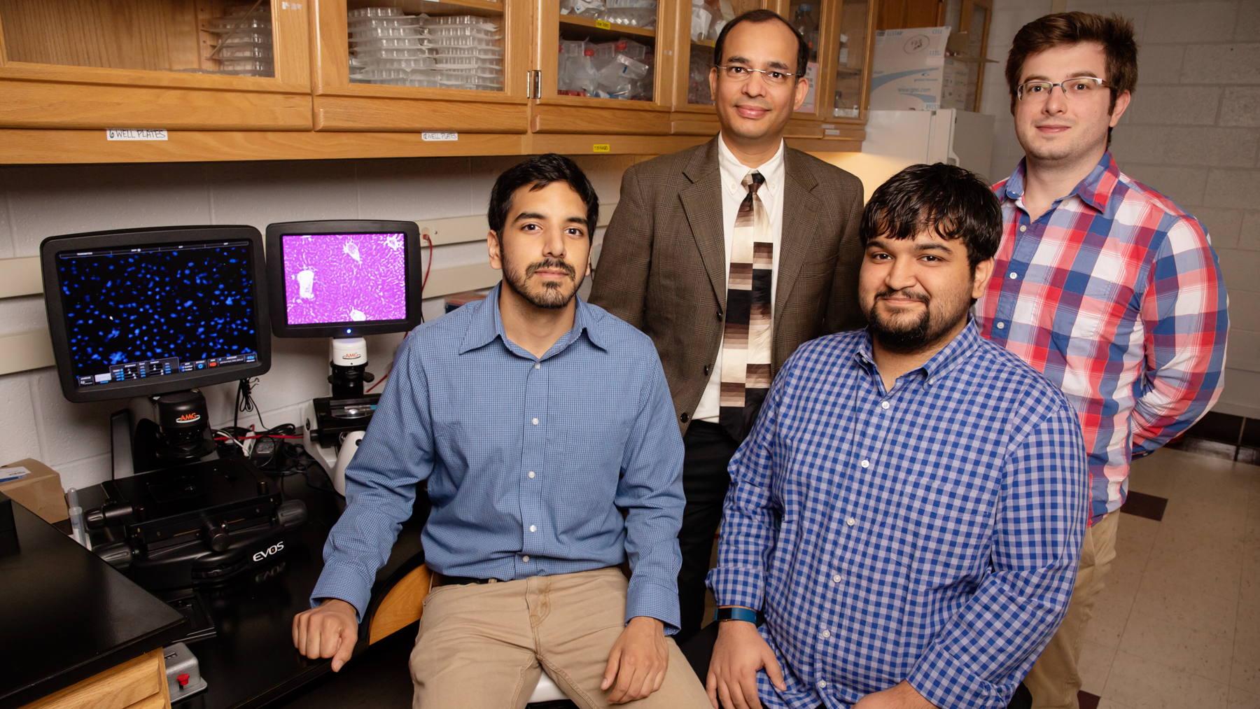 Biochemistry professor Auinash Kalsotra, second from left, and his team, including, from left, graduate students Waqar Arif, Joseph Seimetz and Sushant Bangru
