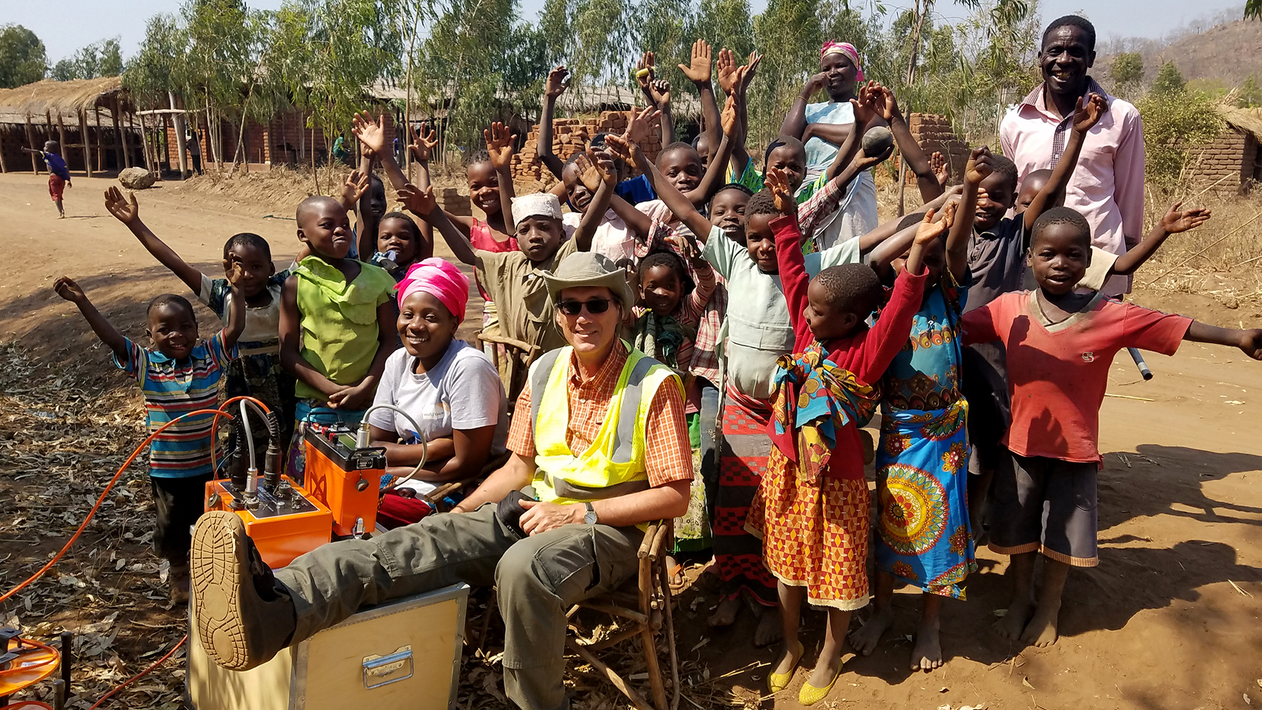 Members of the Geoscientists Without Borders team pose with Jimu villagers after the successful completion of a new village borehole.