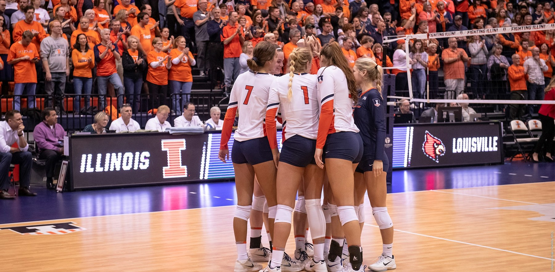 Illinois Volleyball players huddle during a match