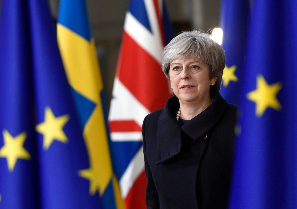 British Prime Minister Theresa May among flags of EU countries