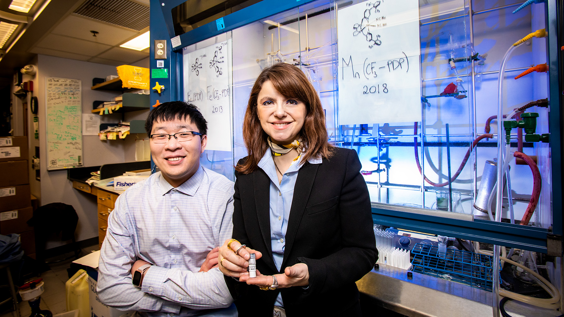 Chemistry professor M. Christina White and graduate student Jinpeng Zhao. Photo by Fred Zwicky