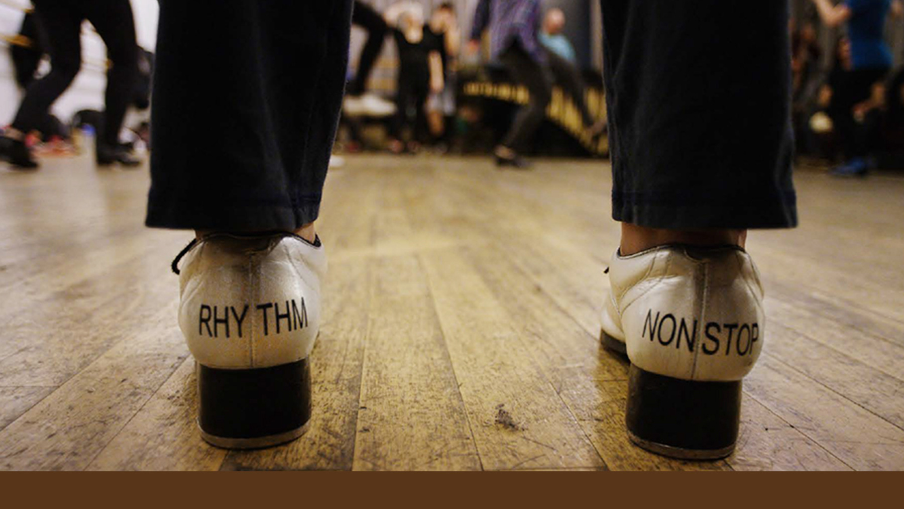 Tap shoes on dancer, printed with the words, 'rhythm' and 'nonstop'. Photo courtesy Institute for The Rhythmic Arts