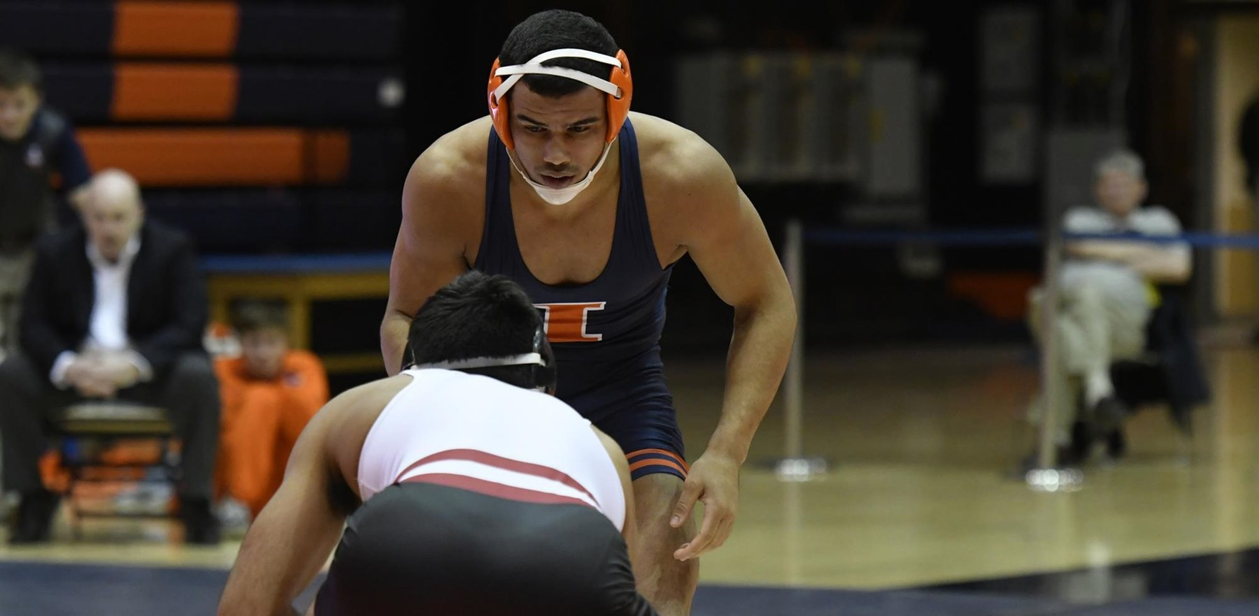 An Illini grappler approaches his opponent