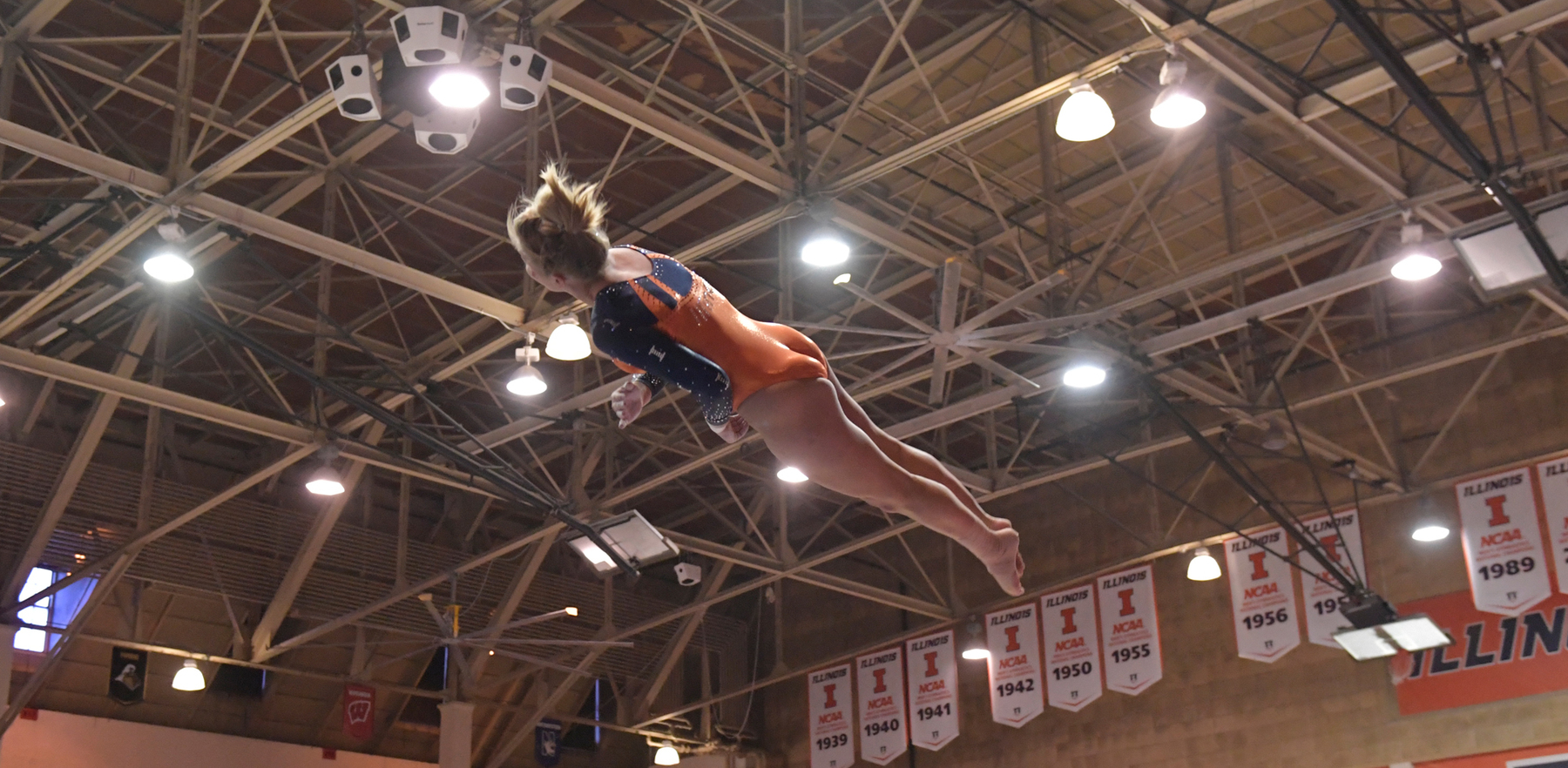 sophomore gymnast Kasey Meeks flies through the air during vault competition