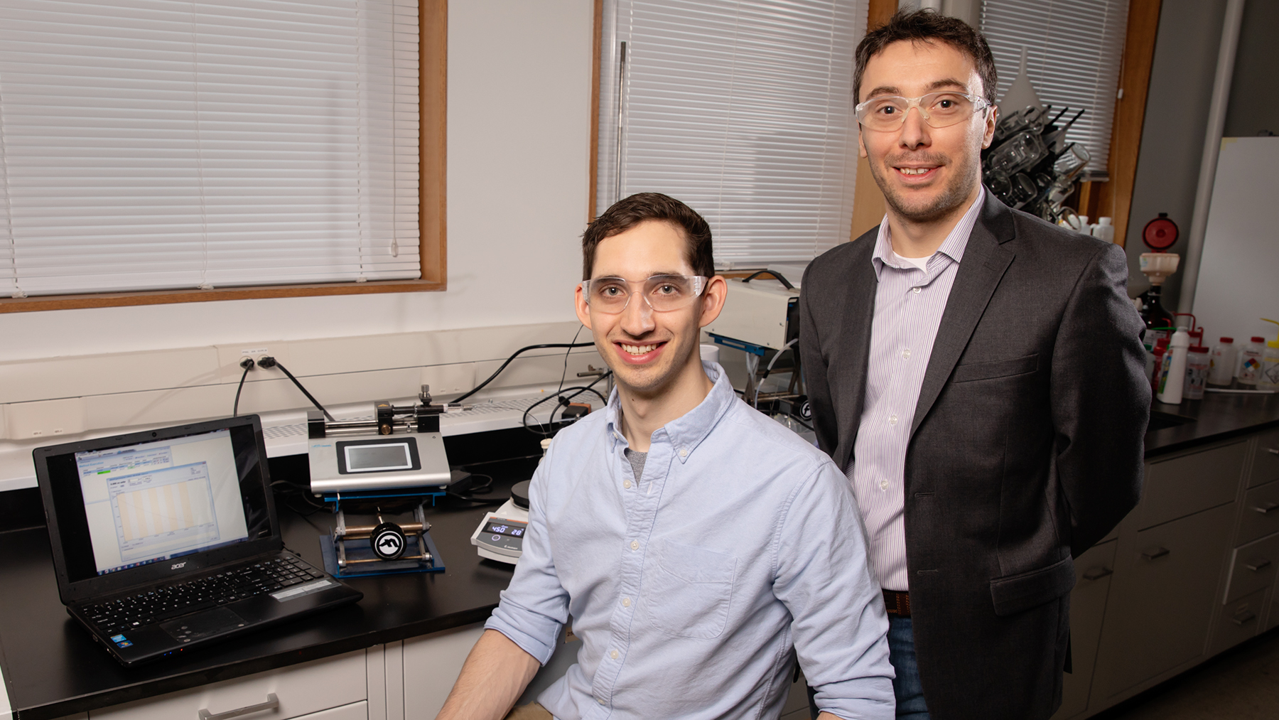 Chemical and biomolecular engineering professor Damien Guironnet, right, and graduate student Dylan Walsh