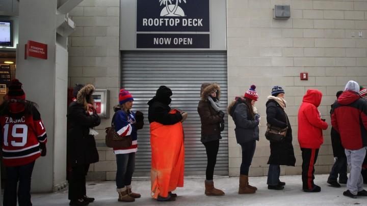 Women wait for a public restroom at Yankee Stadium in 2014.TIM CLAYTON / CORBIS