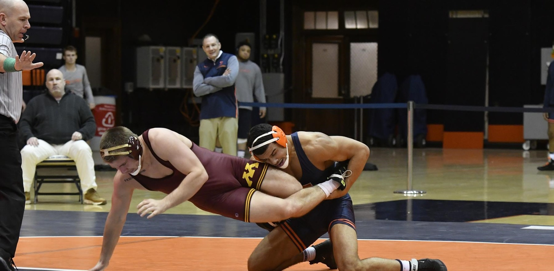 Illini wrestler grapples in a match against Minnesota