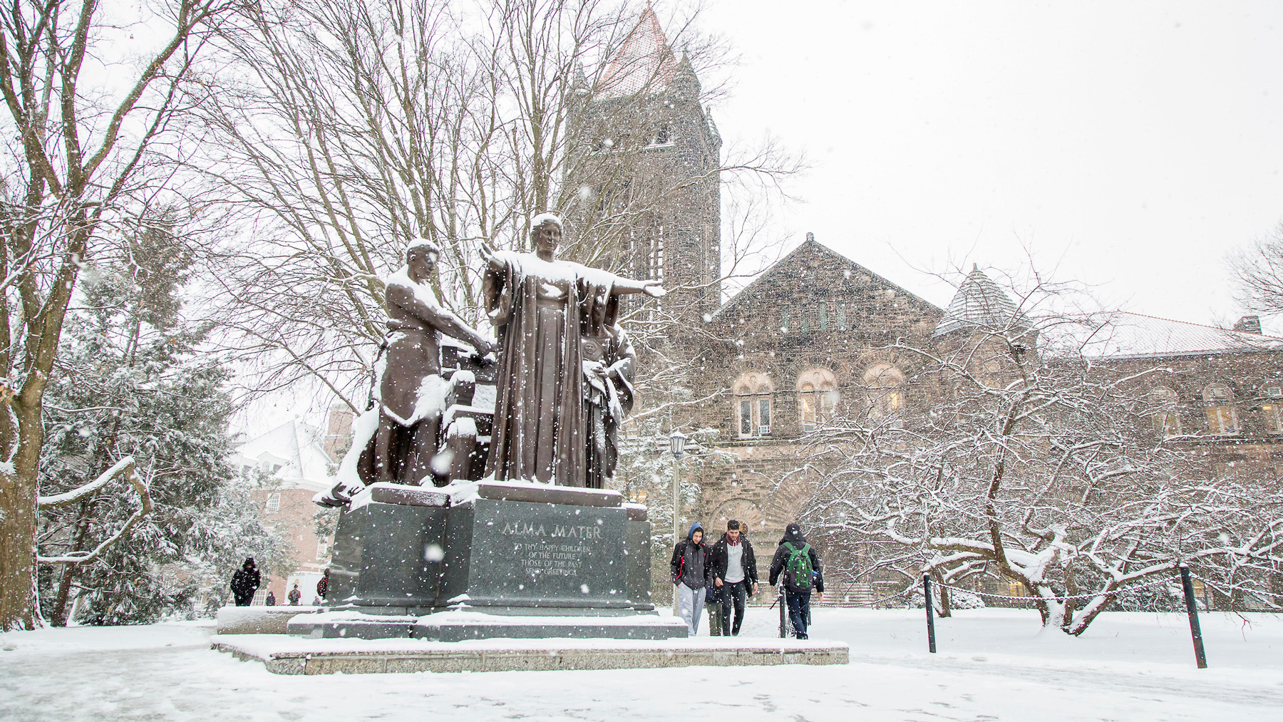 snow covered Alma Mater statue and Altgeld Hall