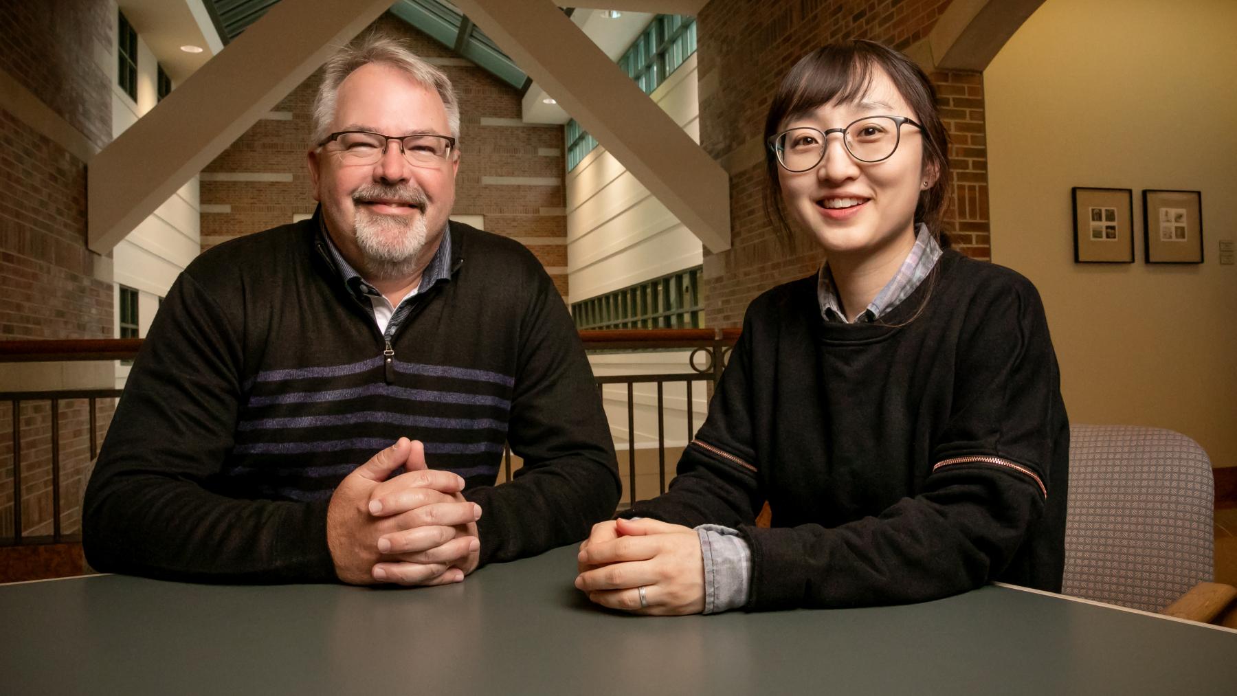 educational psychology professor Kiel Christianson and graduate student Nayoung Kim.  Photo by L. Brian Stauffer