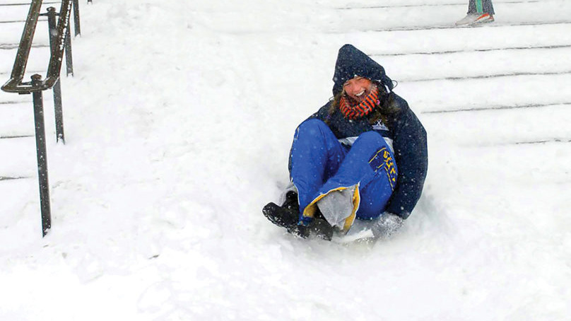 student sleds down the front steps of Foellinger Auditorium in 2007
