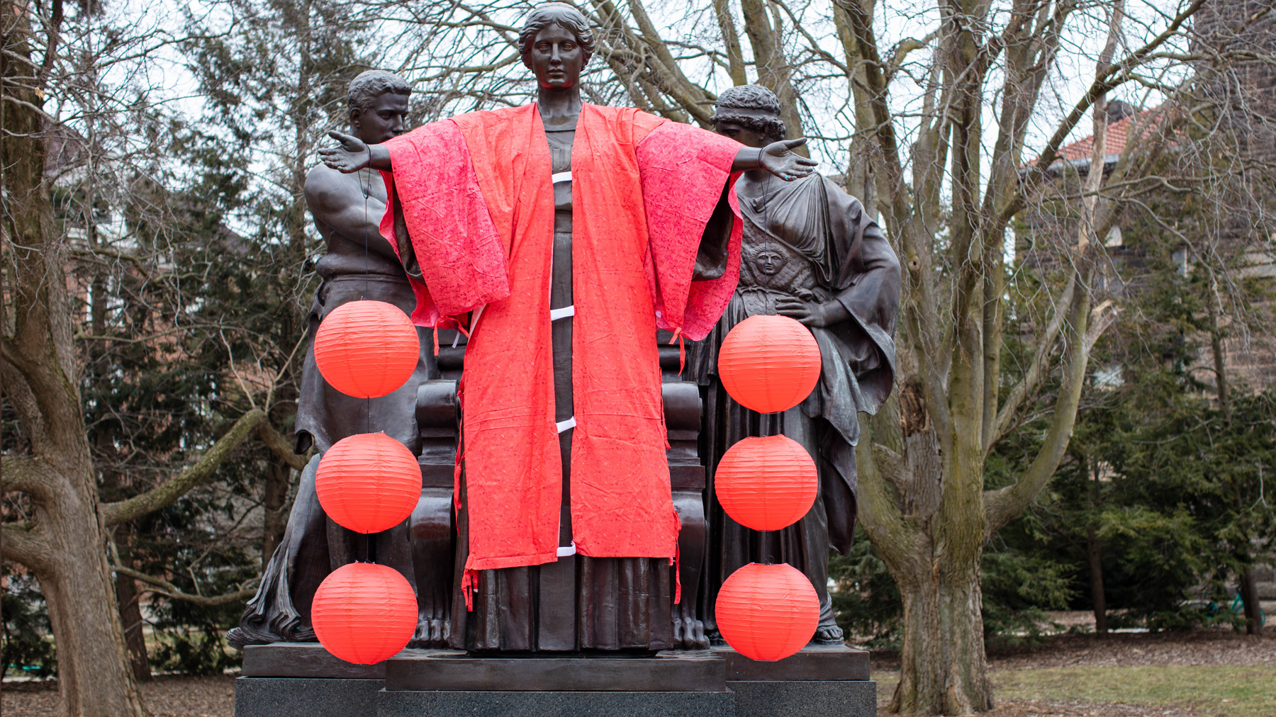 alma mater statue holding red Chinese lanterns