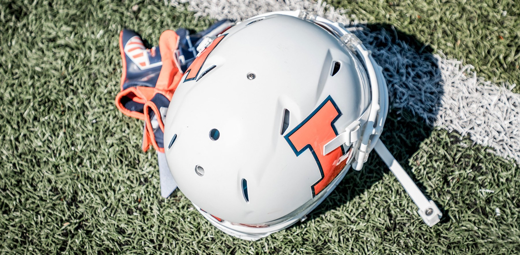 White Illini Football helmet on turf