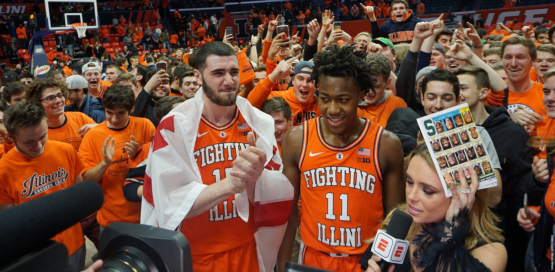 Giorgi Bezhanishvili and Ayo Dosunmu surrounded by fans after a recent victory