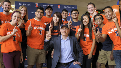 Larry Gies with Gies College of Business students.
