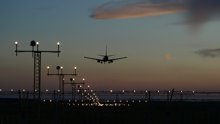 Commercial airplane landing at an airport. Image by skipp604 from Pixabay