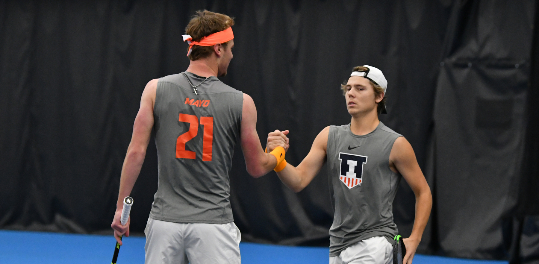 Men's Tennis doubles partners shake hands during a match