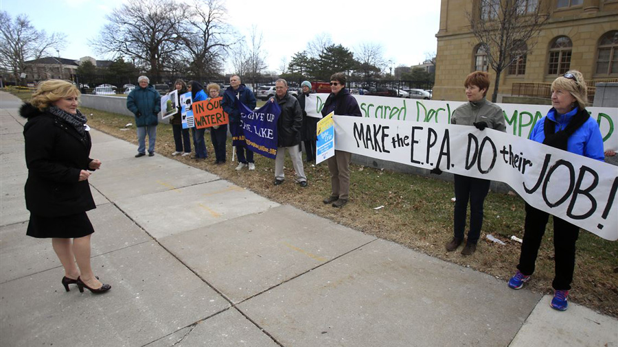 climate change protesters outside a courthouse in Toledo, Ohio. Photo by The Blade