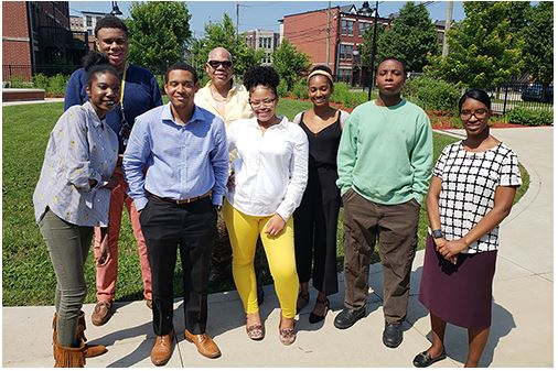 William Conwill, center, a professor in the Department of African American Studies, poses with Illinois students for a photo near Chicago's Oakwood Community Center. Students worked with a non-profit organization to   strengthen community bonds on the city's south side. (Photo courtesy of The Community Builders.)